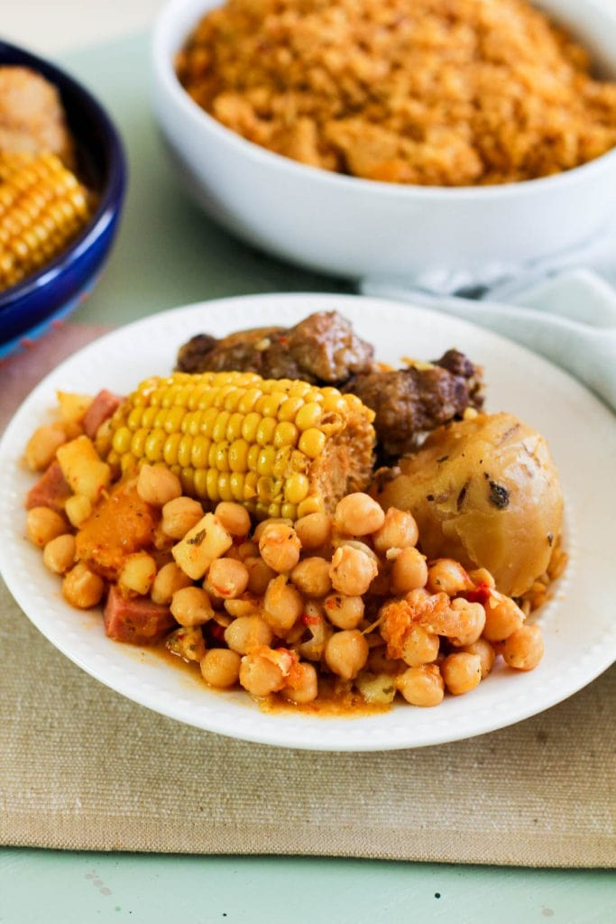 garbanzcos with corn oxtails and a potato